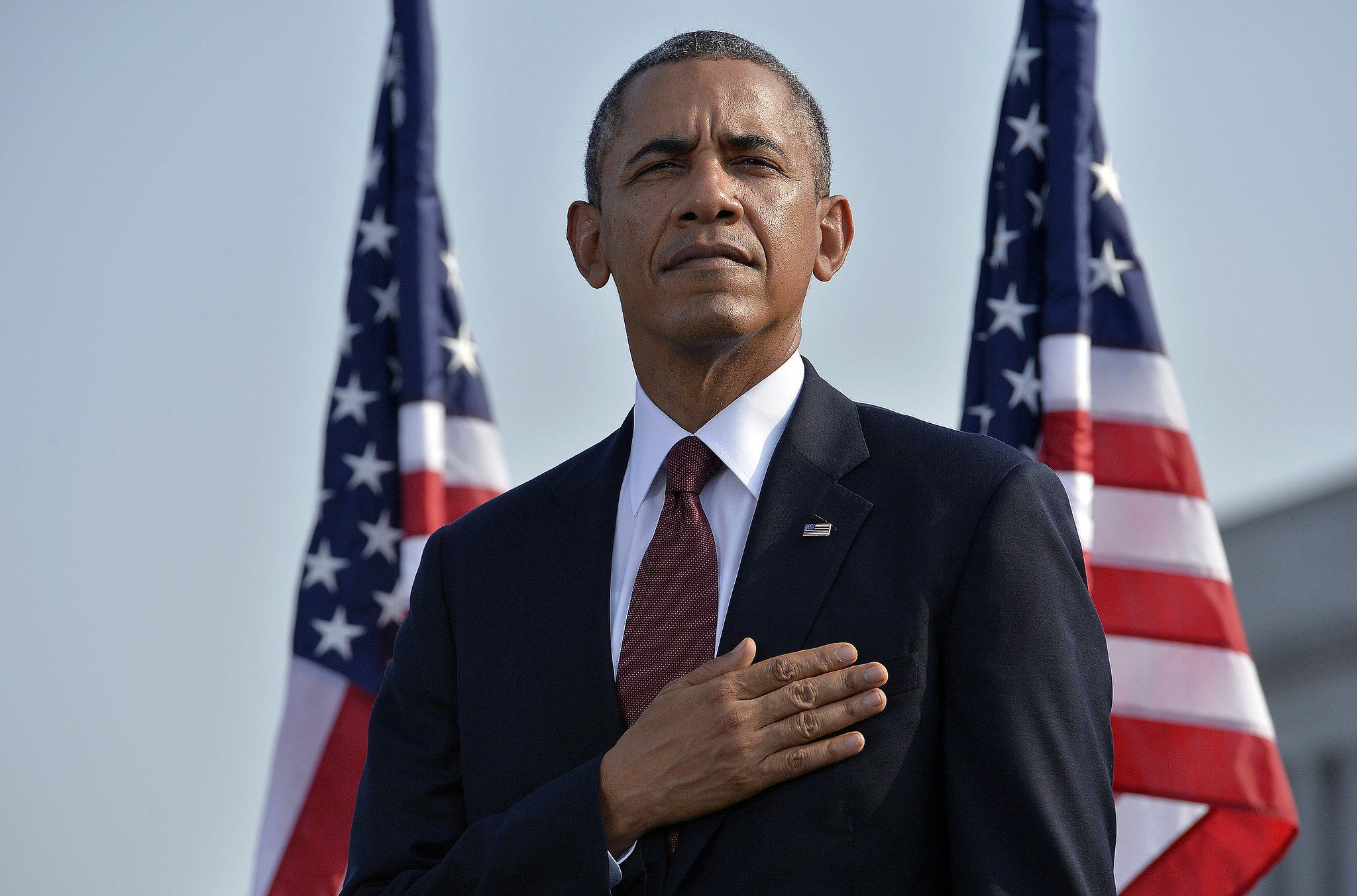 President-Obama-stood-his-hand-his-heart-during-moment