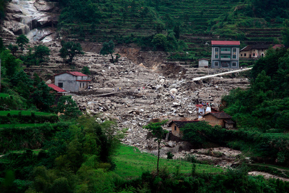 A general view shows damaged homes after flood water swept through Linxiang, central China's Hunan province on June 11, 2011. Floods triggered by torrential rain in southern and central China have killed 52 people and forced more than 100,000 to flee their homes, state media reported. AFP PHOTO