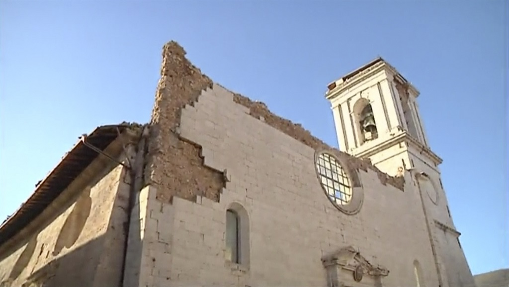 In this image made from video, a damaged church stands in Norcia, Italy, Sunday, Oct. 30, 2016 after a powerful earthquake with a preliminary magnitude of 6.6 rocked central and southern Italy following a week of temblors left thousands homeless. (Sky Italia via AP)
